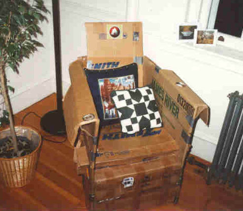 A cardboard chair design made using discarded cardboard boxes.